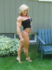 Muscle babe in a minidress.18+