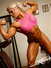 Bodybuilder Lisa Cross is naked in the gym, and as she poses, you can see how powerful and vascular her pecs and biceps are, how ripped her legs and abs are, and how pretty her pussy is. That's naked power.