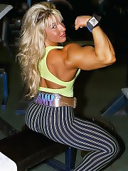 Amy Pazzo' muscularity takes on voluptuousness, featuring huge biceps and a powerfully developed lower body