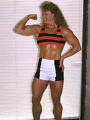 Theresa Nabors posing off season in white shorts/striped halter is very strong
