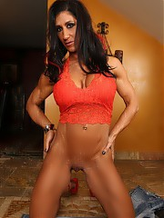 Bodybuilder Elisa Ann flexes her ripped up body, gets naked and has fun with her glass toy.