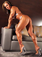 Monica Martin flexing her muscles half naked