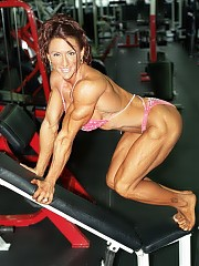 Autumn Raby poses with Nadia they are structurally similar and with similar muscle size and definition
